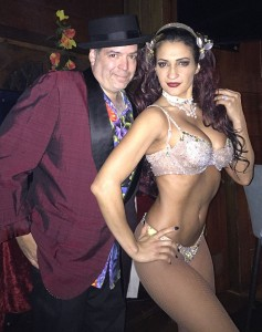 "DJ Riff, aka ""Tiki Chris"" for tropical gigs, with the world famous Marina the Fire Eating Mermaid"